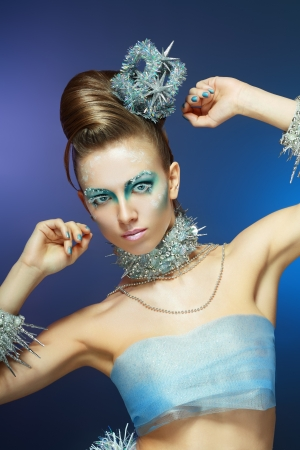 ice-queen. Young woman in creative image with silver artistic make-up. Stock Photo - 17130134