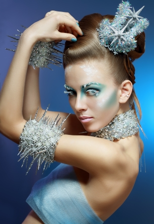 snow-queen. Young woman in creative image with silver blue artistic make-up and perfect hairstyle. Stock Photo - 17130135