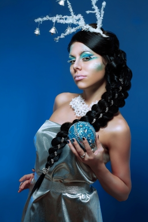 Ice-queen. Young woman in creative image with silver blue artistic make-up and perfect hairstyle. Stock Photo - 17104698