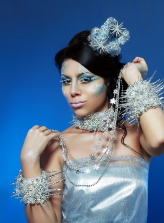 Ice-queen. Young woman in creative image with silver blue artistic make-up and perfect hairstyle. Stock Photo - 17104690