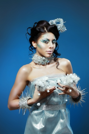 snow-queen. Young woman in creative image with silver blue artistic make-up and perfect hairstyle. Stock Photo - 17104687