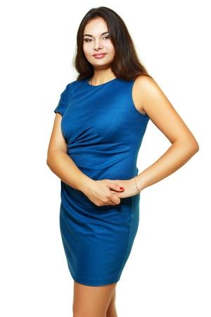 stout: retrato de la hermosa mujer de tama�o m�s joven rubia posando en blanco en el vestido azul Foto de archivo