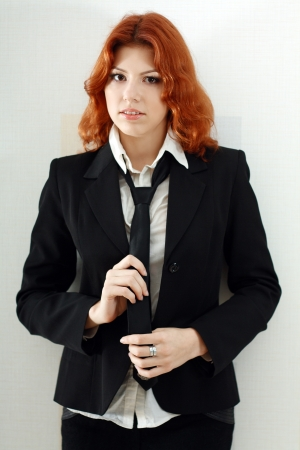 young and cute woman in formal dress like a secretary with white shirt and tie photo