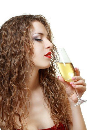 beautiful young woman drinking Champagne white background Stock Photo - 17213199