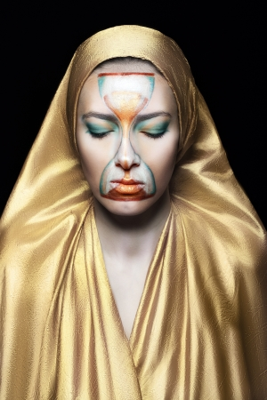 priestess of time model with art make up on her face Stock Photo - 17383296