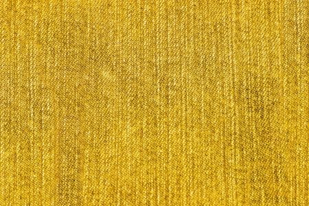 Texture of yellow jeans as a background  photo