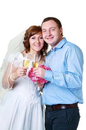 Bride and groom in studio with glasses of champagne in their wedding day photo
