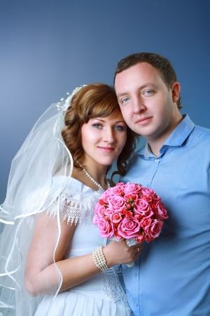 Bride and groom in studio on their wedding day photo