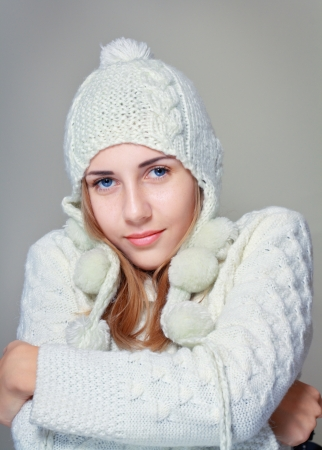 beautiful woman in warm clothing on grey background photo