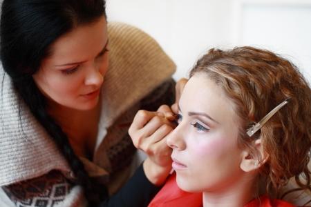 make up artist creating art make up on model's face Stock Photo - 17481024
