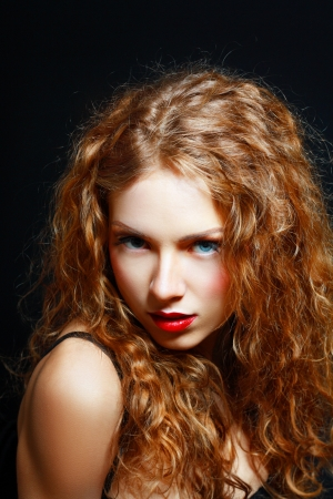 tresses: Portrait of a Beautiful Hot Girl With Long Curly Red Hair