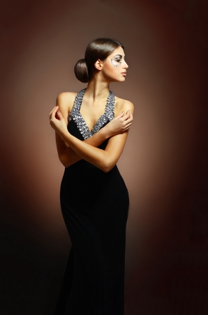 beautiful woman in sexy evening dress against dark background Stock Photo - 17506620