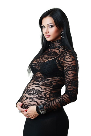 Beautiful pregnant woman expecting and smiling dressed in spandex dress photo
