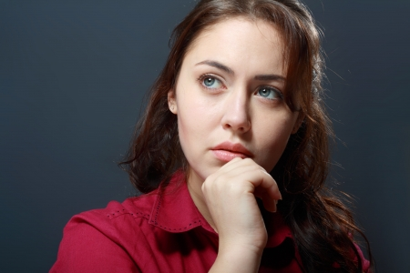 Young Caucasian woman looking sad or thoughtful Stock Photo - 17506596