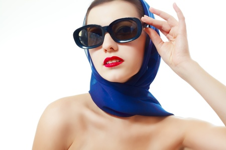 young stylish caucasian woman in glasses and headscarf posing, isolated over white, retro styling