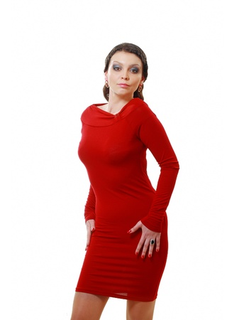 Happy young woman in red dress. Isolated over white background. photo