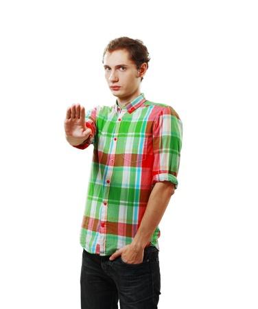denial: young man saying stop; denial gesture