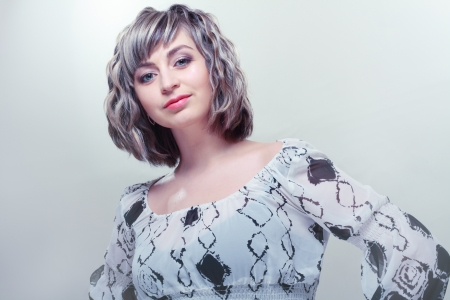 beautiful woman with short hair style. Silver blue tone photo
