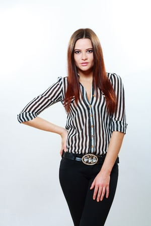 Image of amazing young female fashion model in pants and striped shirt photo
