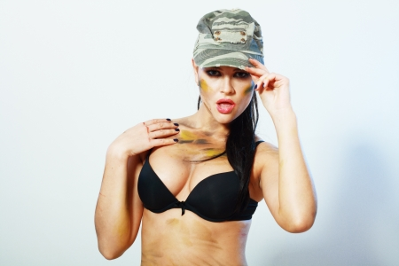 portrait of sexy camo girl in hat and black lingerie