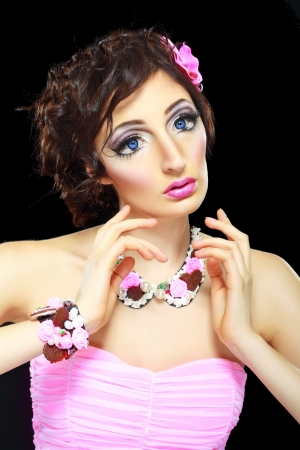 Fashion model with barbie doll make-up, long eyelashes, big blue eyes photo