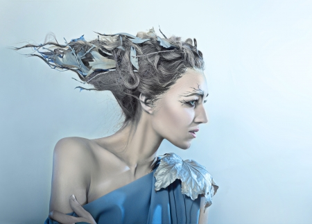 beatiful high fasion female model with fantasy hair style and art make up nature concept photo