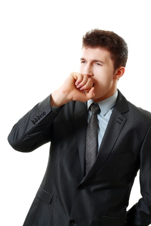 yawning young business man, isolated on white background  photo