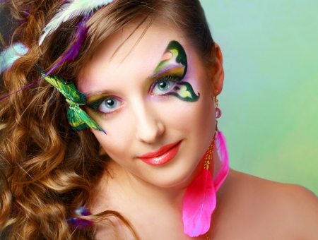 eyeshades: Young model beautyful women with perfect butterfly make up and hairstyle clouse-up