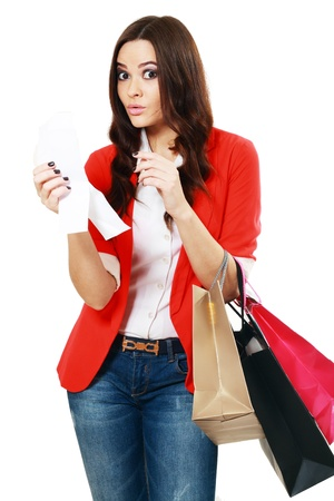 worried woman: young woman shocking after checking over the receipt in her hands and spending too much  Stock Photo