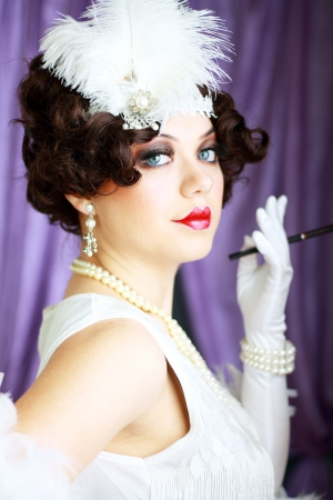Beautiful young woman portrait in retro flapper style headband Vogue style vintage photo