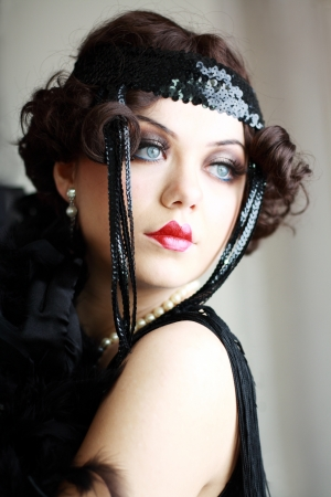 roaring 20s: Girl dreaming beautiful young flapper woman from roaring 20s