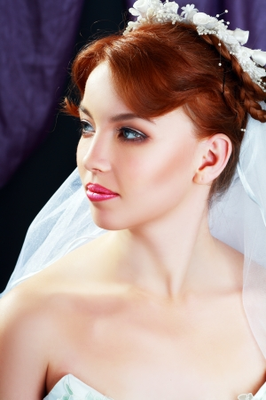 beautiful bride portraite with perfect bridal make up and hairstyle photo