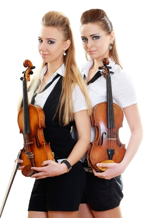 two beautiful young woman with violins isolated over white photo
