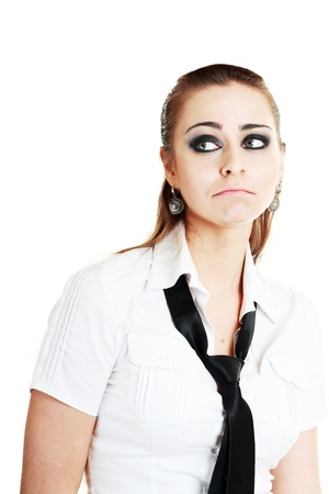 Young woman looking left with expression as she is disappointed about something  photo