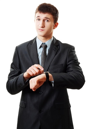 business man looking to the camera and pointing at his watch over white Stock Photo
