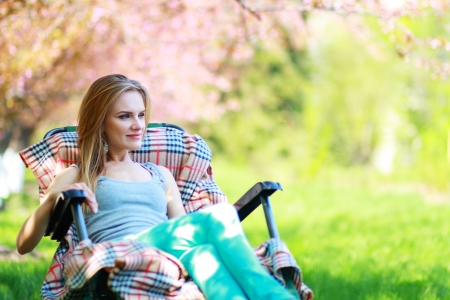 woman relaxing on lounger in the spring garden  photo