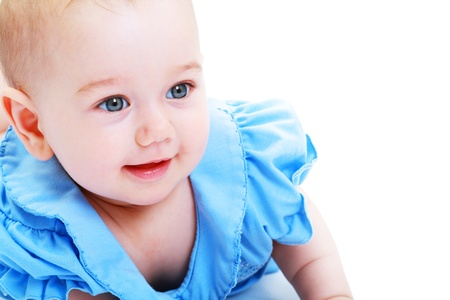 Close-up of sweet little baby girl in blue dress isolated over white Stock Photo