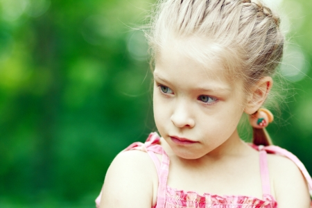 Close-up portrait of adorable sad child girl Sallow DOF photo