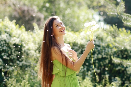Cute woman in the park with dandelions  photo
