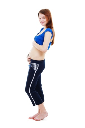early pregnancy: beautiful young woman she is in her four month of pregnancy