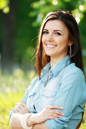 surprised overjoyed happy woman outdoor over green background