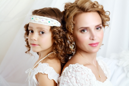 beautfiul mother and daughter of the woman of retro vintage fashion photo