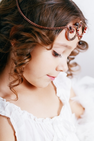 little princess close up beautiful cute girl wearing diadem photo