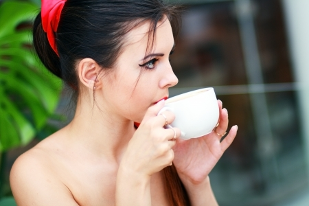 Portrait of beautiful elegant woman with coffee cup photo