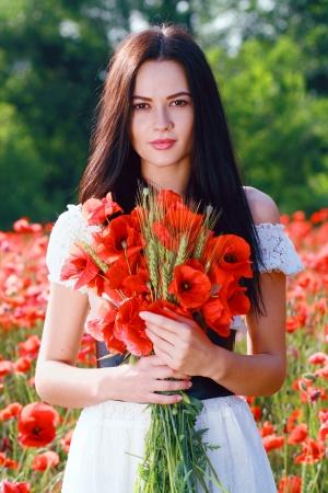 sexy angel: beauty woman in poppy field in white dress