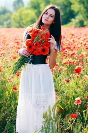 sexy angel: beauty woman in poppy field in white dress