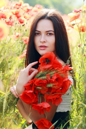 Series. Young girl with long hair in poppies field soft summer colors photo
