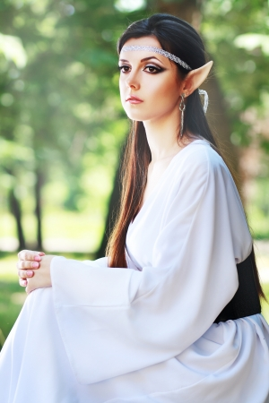 an elf princess lights up the way to the woodland area