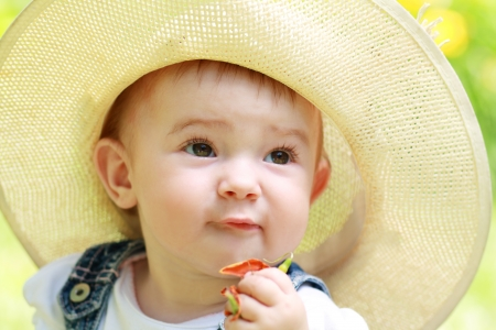 outdoor seating: Cute baby girl portrait outdoor in summer day