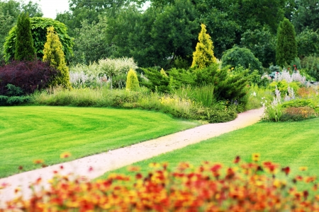 landscape garden: A stone walkway winding its way through a tranquil garden.  Stock Photo